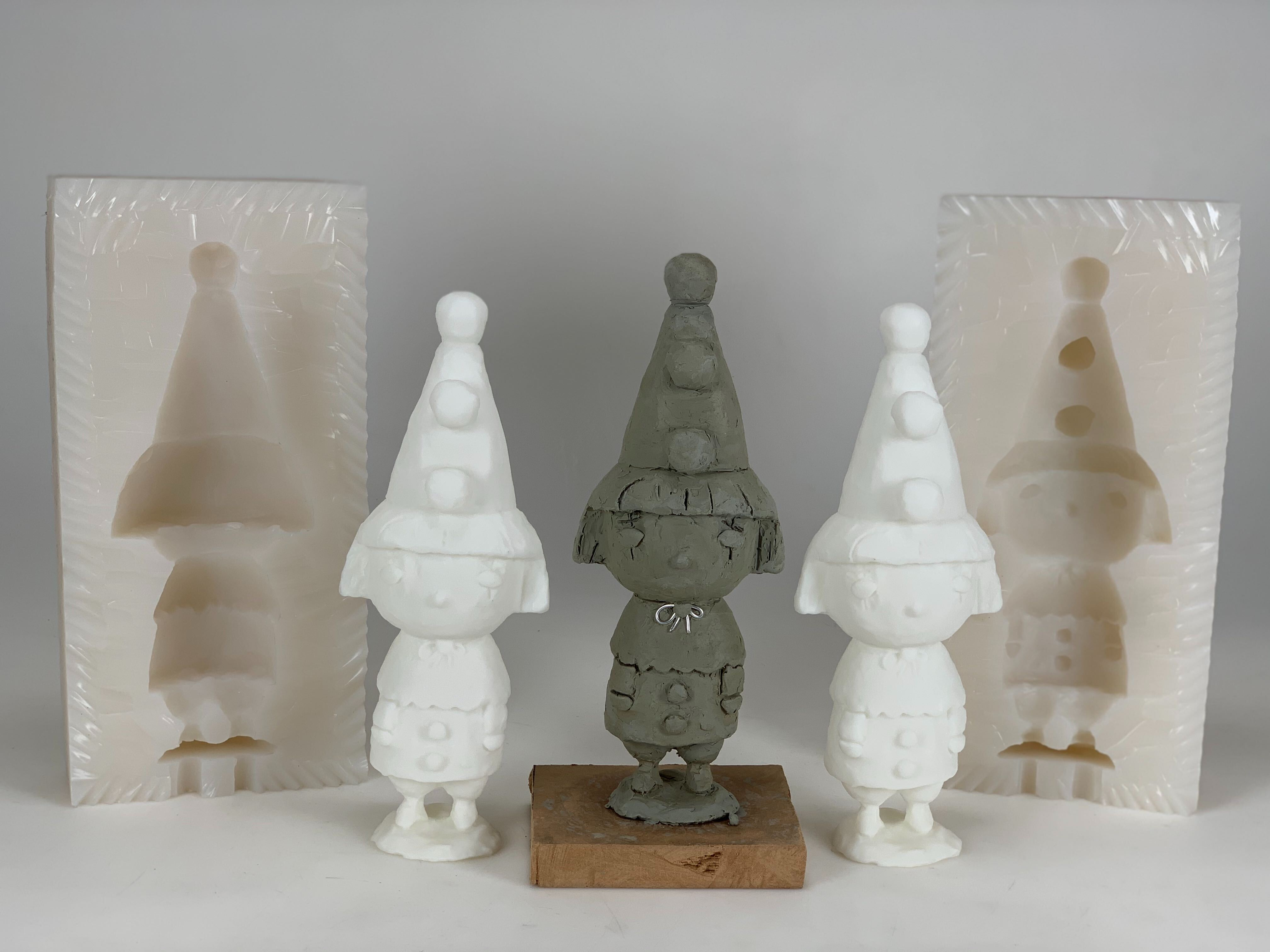 a clay sculpture is 3d scanned to produce 3d printed copy replicas and a 2-part silicone mold for resin casting sculpture copy replicas